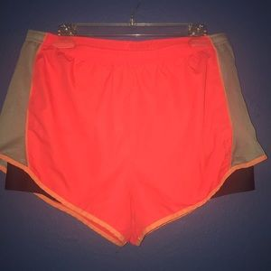 Running shorts with compressed shorts under